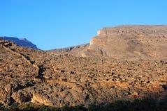 Fördärvar av gamla gyttjig landremsabyggnader i staden Biladt Sait i Oman Royaltyfri Fotografi