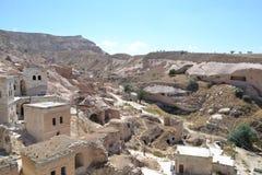 Fördärvar och hus i Cappadocia Fotografering för Bildbyråer