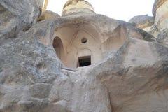 Fördärvar och infallhus i Cappadocia Arkivfoton