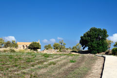 Fördärvar och kyrkan av Alcudia Arkivbild