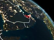 Förenade Arabemiraten i rött på natten Arkivfoton