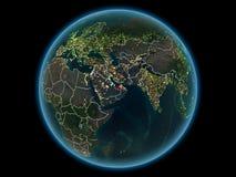Förenade Arabemiraten på planetjord från utrymme på natten arkivbild