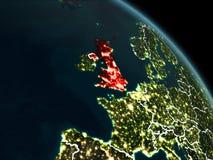 Förenade kungariket i rött på natten Royaltyfria Foton