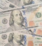 Förenta staternavaluta hundra bakgrund för dollarräkningar Fotografering för Bildbyråer