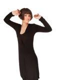 Föreställa av en härlig sensualitykvinna i svart posera för klänning Arkivfoton