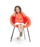 Flicka med hörlurar Arkivfoton