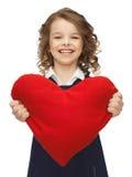 Flicka med stor hjärta Arkivbild