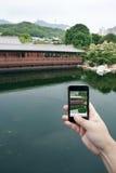 föreställer att ta för smartphone Arkivfoto