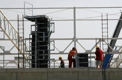 företags arbetare för byggnadskonstruktion Royaltyfria Foton