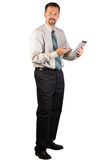 Företags man som står och använder en minnestavla Arkivfoton