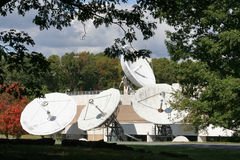 Företags satellit- disk Arkivfoton