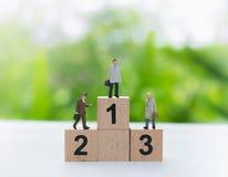 Företagsledare-, victorie- och prestationbegrepp arkivfoto