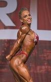 Förföriskt och Buff Pro Fitness Winner royaltyfria bilder