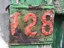 Förfalla plattan markerade 128 Arkivfoton