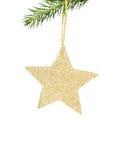 Förgrena sig den skinande guld- stjärnan för jul på gran med garneringar I Fotografering för Bildbyråer