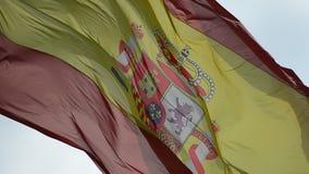 Förgrund av att vinka för Spanien flagga