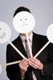 Förklädnad: Affärsman Hiding Behind Variety av maskeringar Arkivbilder
