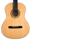 Förkroppsliga den klassiska gitarren med det gula däcket på vit bakgrund Royaltyfria Bilder