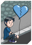 Förkrossat ledset sammanträde för ung man på trottoaren Arkivfoton