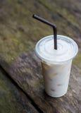 Förkylning mjölkar i exponeringsglaset Arkivbild