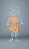Förlagd kläder i handling med kvinnateckningen Arkivfoton