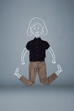 Förlagd kläder i handling med kvinnateckningen Arkivbilder