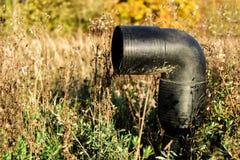 Förlorat svart plast- rör Arkivbilder