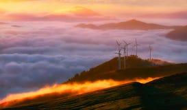 Förnybara energikällor med vindturbiner Fotografering för Bildbyråer