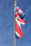 Förolämpningrörelse för facklig flagga i vind arkivfoto