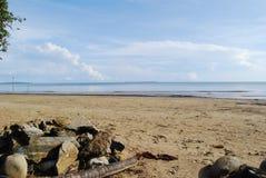 förorenad strand Arkivbilder