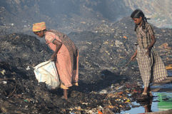 Förorening och armod Arkivfoto