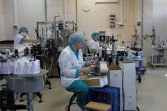 Förpacka det färdigt - produkter i företaget Vita Royaltyfria Bilder
