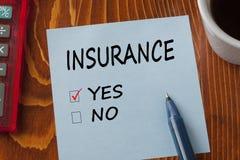 Försäkring som är skriftlig på anmärkningsbegrepp arkivfoto
