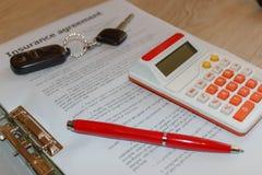 Försäkringpolitik och tangent från bilen Form för bilförsäkring med c Royaltyfri Fotografi
