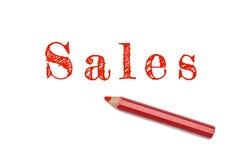 Försäljningar skissar den röda blyertspennan Arkivfoto