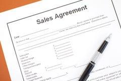 Försäljningsöverenskommelse Arkivbild