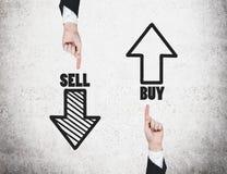 Försäljnings- och köppilar arkivbild