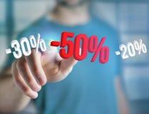 Försäljningsbefordran 20% 30% och 50% som flyger över en manöverenhet - Shopp Royaltyfria Bilder