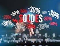 Försäljningsbefordran 20% 30% och 50% som flyger över en manöverenhet - Shopp Arkivbilder