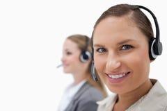 Försäljningspersoner som använder hörlurar med mikrofon Fotografering för Bildbyråer