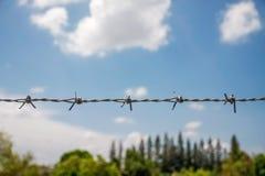 Försett med en hulling staket med blå himmel Fotografering för Bildbyråer