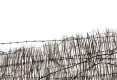 Försett med en hulling - tråd och staket Arkivbilder