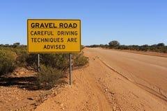 Försiktigt körande tecken för grusväg Fotografering för Bildbyråer