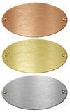 Försilvra guld- och brons belägger med metall ellips pläterar isolerat royaltyfria bilder