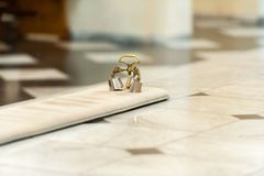Försilvra klockor i kyrkan för ceremoni royaltyfri foto