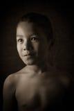 Förskräckt ung asiatisk pojke Royaltyfria Foton