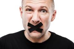 Förskräckt vuxen stängd mun för man tejp Fotografering för Bildbyråer