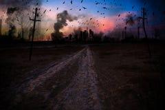 Förstörd stad i rök arkivbilder