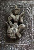 Förstörd träsnida skulptur arkivbild