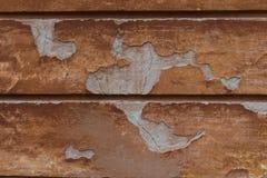 Förstörd vägg för åldrig apelsin sprucken murbruk Detaljerad tappningbakgrund arkivbild